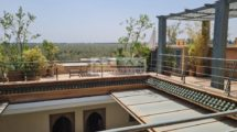 Superb uncluttered riad panoramic view over magnificent gardens and the Atlas